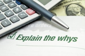 explain the whys printed on book with calculator and pen